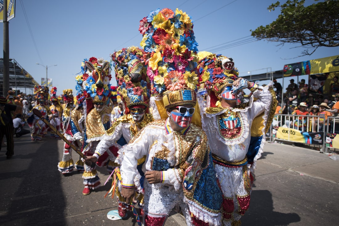 A group showing off for the crowd their costumes during the Batalla de Flores. RewritingtheMap/Emanuel Echeverri